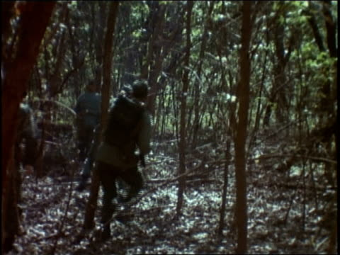 infantry advancing through forest / vietnam - infantry stock videos & royalty-free footage