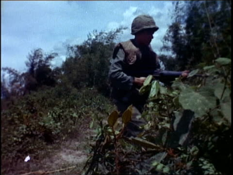 infantry commander leading soldiers through jungle / vietnam - infantry stock videos & royalty-free footage
