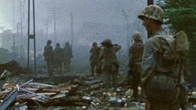 WS Infantry resting and advancing through rubble / Saipan Mariana Islands
