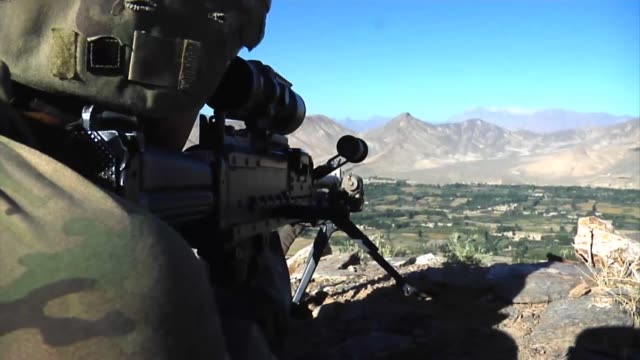 infantry soldiers from forward operating base airborne set up a new observation post on the ridge of a mountain to scan for enemy activity. - sniper stock videos & royalty-free footage