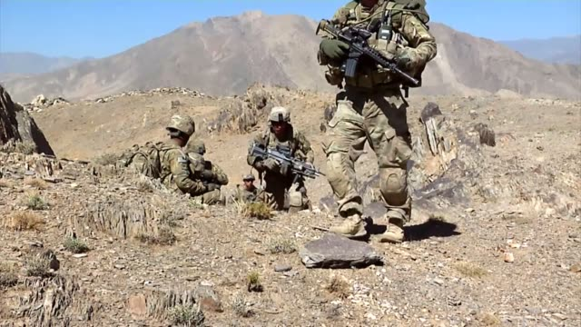 infantry soldiers from forward operating base airborne set up a new observation post on the ridge of a mountain to scan for enemy activity. - conflict stock videos & royalty-free footage