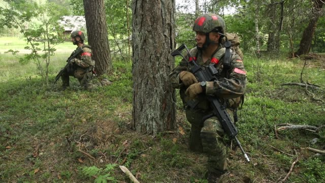 infantry soldiers of the bundeswehr the german armed forces take part in a reconassaince mission during thunder storm 2018 multinational nato... - infantry stock videos & royalty-free footage
