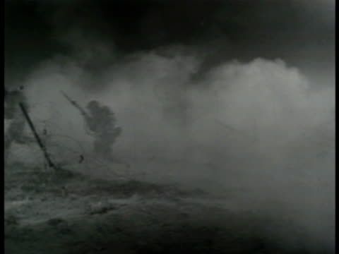 Infantry soldiers running through smoke screen cover US Soldiers in gas masks running out of gas cloud WWII training