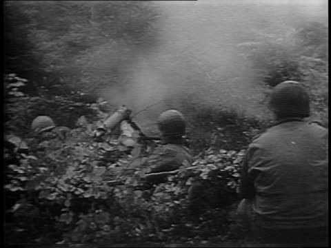 infantrymen camp behind the front line / soldier shaving next to a clothes line / closeup shots of two men making a fire and cleaning a gun / soldier... - gewehr stock-videos und b-roll-filmmaterial