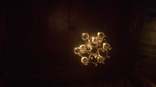 Infestation 3: Swarms of Laron/flying ants invade a chandelier in a traditional wooden house in Central Java, Indonesia
