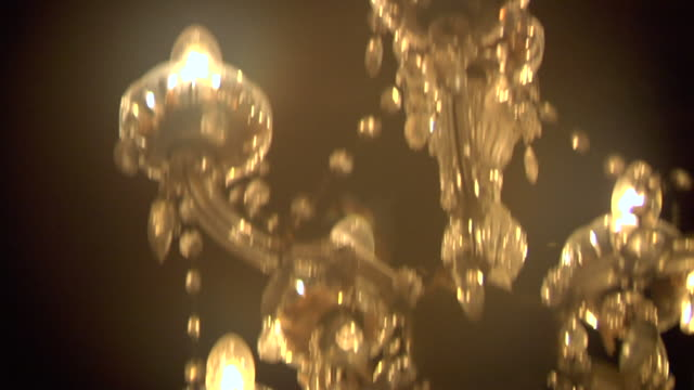 infestation 6: swarms of laron/flying ants invade a chandelier in a traditional wooden house in central java, indonesia - infestation stock videos & royalty-free footage