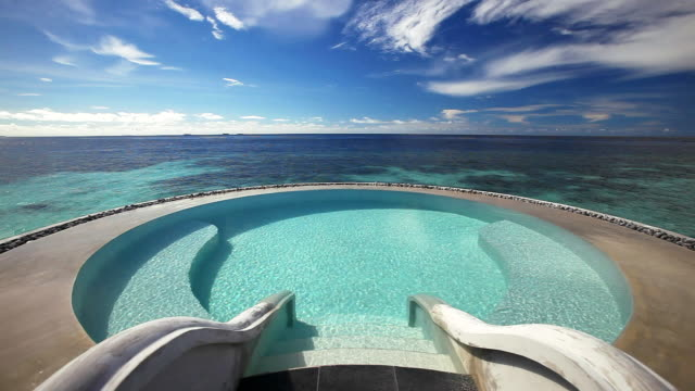 Infinity pool and tropical lagoon, Maldives, Indian Ocean