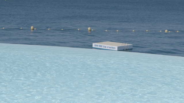 ws infinity pool at hotel du cap with sea in background / antibes, france - infinity pool stock videos & royalty-free footage