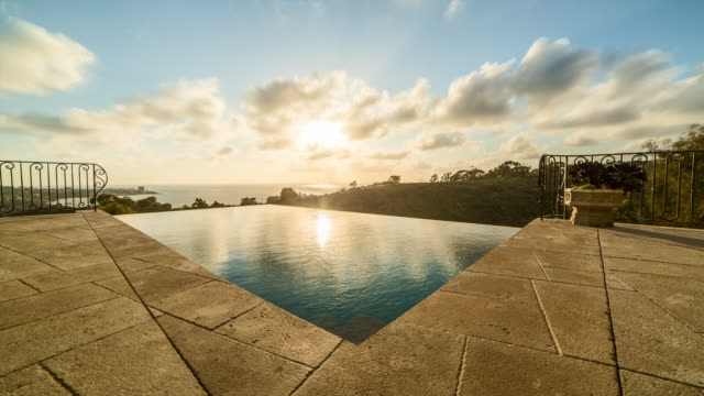 infinity pool at sunset, time lapse - infinity pool stock videos & royalty-free footage