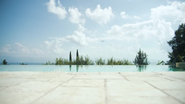 infinity pool overlooking ocean - infinity pool stock videos & royalty-free footage