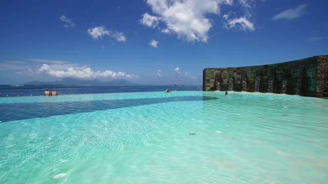 infinity pool overlooking the ocean and moorea island - moorea stock videos and b-roll footage