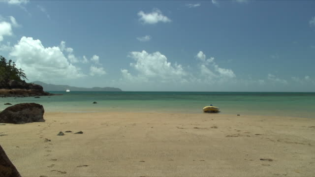 WS Inflatable raft on beach shore, Whitsunday Islands, Queensland, Australia