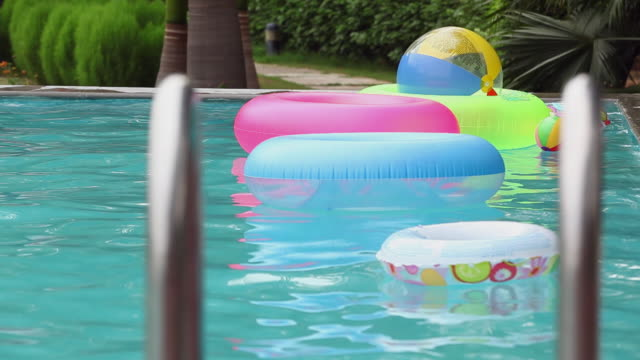 inflatable rings and ball floating in the swimming pool, delhi, india - inflatable stock videos and b-roll footage