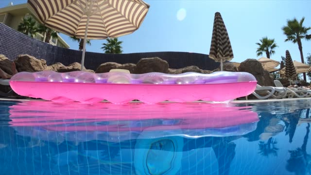inflatable water mattresses float on the water - inflatable raft stock videos & royalty-free footage
