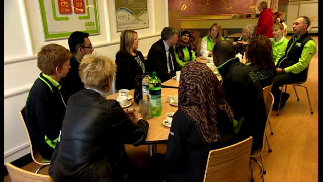 Inflation falls to four year low of 16 per cent Cambridgeshire Peterborough INT Various of Ed Ball MP seated talking with group of Asda workers...