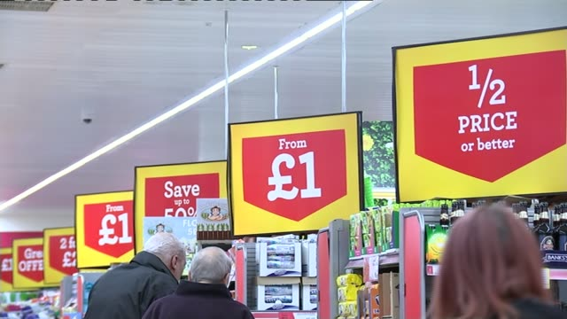 inflation falls to minus 01 percent england int various shots people shopping in supermarket with bargain price signs visible vox pops various shots... - reduction stock videos and b-roll footage