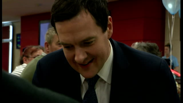 Inflation figures fall to four year low WALES Cardiff INT Various shots of George Osborne MP playing bingo