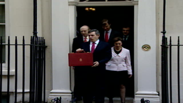 inflation rises above target for first time in ten years r21030705 ext gordon brown mp outside number 11 downing street with budget briefcase - first occurrence stock videos and b-roll footage