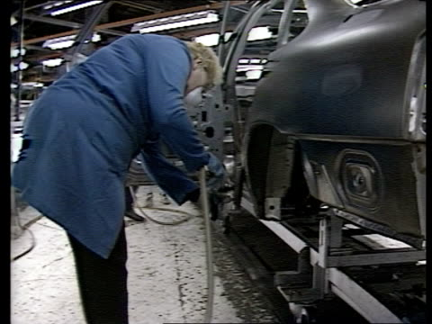 inflation up; inflation up; itn lib luton: car factory side man bending over as welding bodywork of car bv worker buffing bodywork of car - bending over stock videos & royalty-free footage