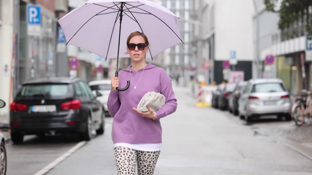 influencer alexandra siedschlag wearing a leo printed leggings by hey honey, a lila colored cashmere pullover by la residence, white sneakers by... - leggings stock videos & royalty-free footage