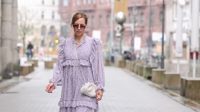influencer alexandra siedschlag wearing a lila colored dress with volants by stella nova, brown boots by isabel marant, a white bag by seen on her,... - arts culture and entertainment stock videos & royalty-free footage