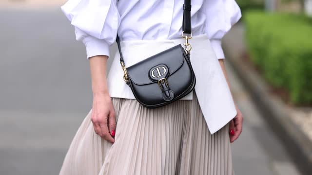 influencer gitta banko, wearing a beige pleated maxi skirt with a white leather belt by nobi talai, a white blouse by nobi talai, a black bag by... - beige stock videos & royalty-free footage