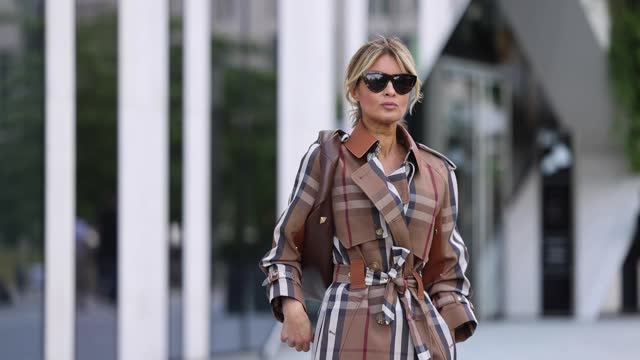 influencer gitta banko wearing a brown and beige checkered trenchcoat by burberry, a beige long silk skirt by nanushka, a dark brown bag by... - silk stock videos & royalty-free footage