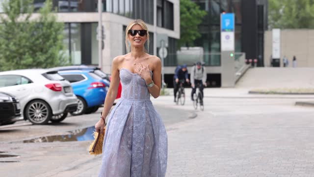 influencer gitta banko wearing a bubble low ponytail hairstyle, a periwinkle colored strapless lace midi dress 'olivia blue' with embroidered flowers... - satin stock videos & royalty-free footage