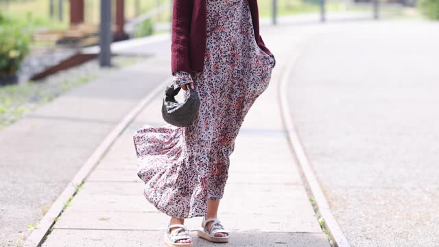 influencer gitta banko wearing a cream coloured maxi dress with orange and dark brown floral print by a londree, a burgundy cardigan by wommelsdorff,... - cardigan sweater stock videos & royalty-free footage