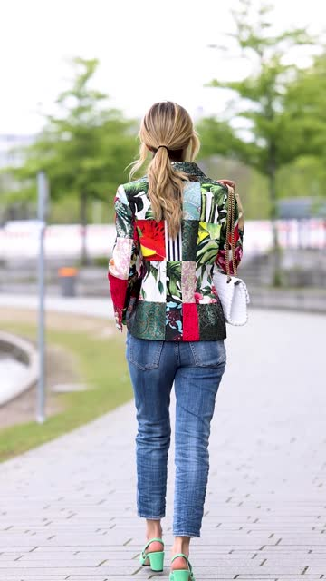 influencer gitta banko wearing a multicolor blazer with different floral design by dolce & gabbana, a white tank top with gold logo by dolce &... - vest stock videos & royalty-free footage