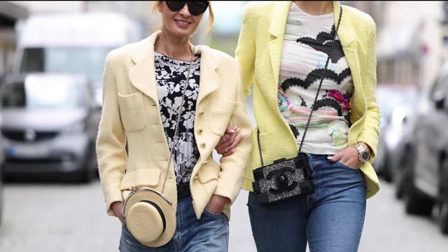 influencer gitta banko, wearing a vanilla colored blazer by chanel, a black and white floral top by chanel, blue denim jeans pants by saint laurent,... - beige stock videos & royalty-free footage