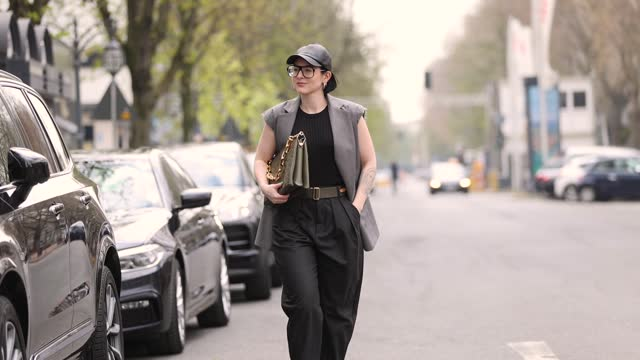 influencer maria barteczko wearing a black ribbed top by arket, a grey sleeveless vest by source unknown, grey wool trousers by zara, black leather... - sleeveless top stock videos & royalty-free footage