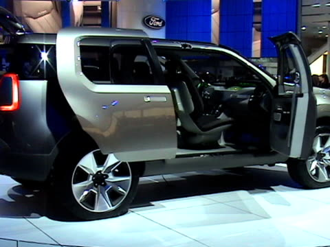 cu info sign / ws front end of explorer concept revolving on turntable / ws rear end / ms rear end picnic seats protruding from rear bumper / cu rear... - anamorphic stock videos and b-roll footage
