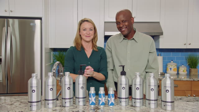 infomercial hosts discuss the sustainable benefits of aluminum bottles over plastic while promoting eco-friendly body and hair care products. - comparison stock videos and b-roll footage