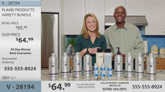 infomercial hosts excitedly gesture and talk to camera to promote a variety of eco-friendly body and hair care products on display in promotional video. - hair conditioner stock videos and b-roll footage