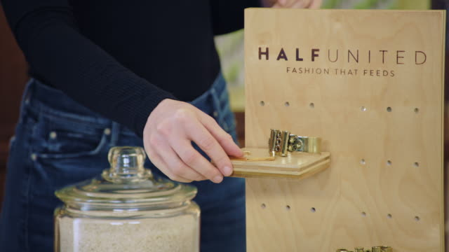 cu. infomercial hosts promote jewelry from charitable apparel company half united. - charity benefit stock videos & royalty-free footage