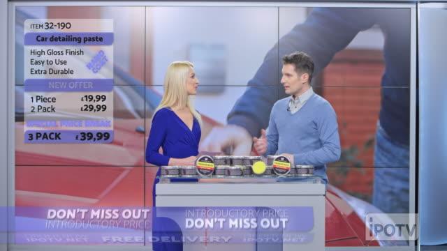 uk infomercial montage: female host introducing male car wax presenter on the show - strategia di vendita video stock e b–roll