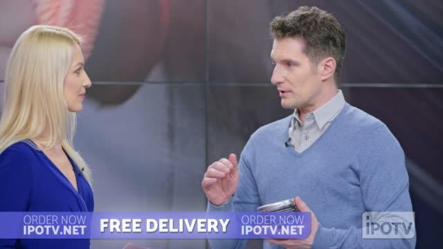 us infomercial montage: female host introducing male car wax presenter on the show - strategia di vendita video stock e b–roll