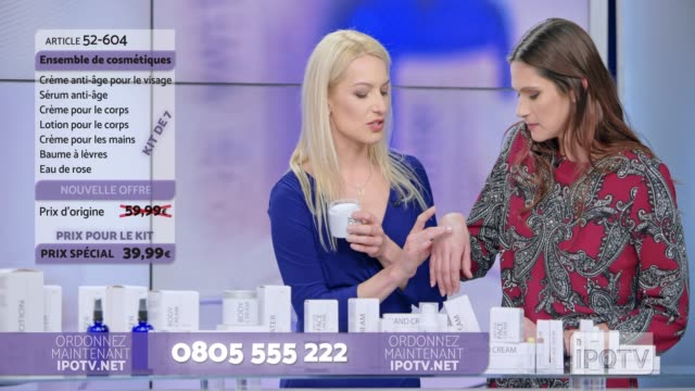 infomercial montage in french: woman presenting a cosmetic line on an infomercial show rubbing cream onto the hand of a female model while talking to the female host - product variation stock videos & royalty-free footage