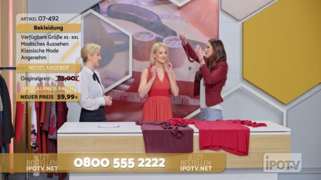 infomercial montage in german: stylist on a tv show talking about the dress the model is wearing and placing a necklace around her neck while talking with the to the female host - television commercial stock videos & royalty-free footage