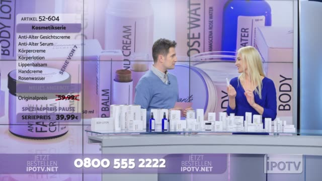 infomercial montage in german: woman presenting a cosmetic line on an infomercial show placing the product onto the male host's hand as they talk - western script stock videos & royalty-free footage