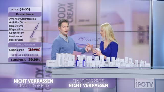 infomercial montage in german: woman presenting a cosmetic line on an infomercial show rubbing some cream onto the back of the male host's hand as they talk - group of objects stock videos & royalty-free footage