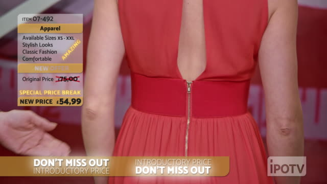 uk infomercial montage: stylist on a tv show talking about the dress the model is wearing and placing a necklace around her neck while talking with the to the female host - strategia di vendita video stock e b–roll