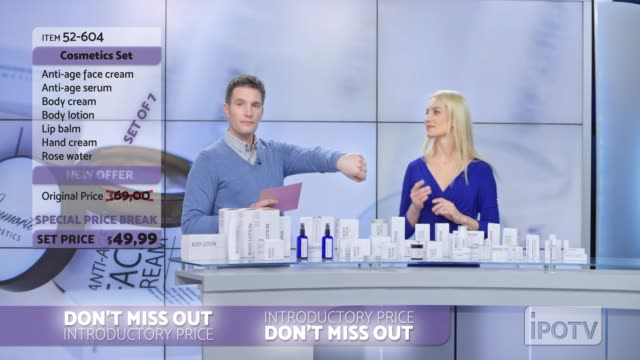 us infomercial montage: woman presenting a cosmetic line on an infomercial show rubbing some cream onto the back of the male host's hand as they talk - presenter stock videos & royalty-free footage