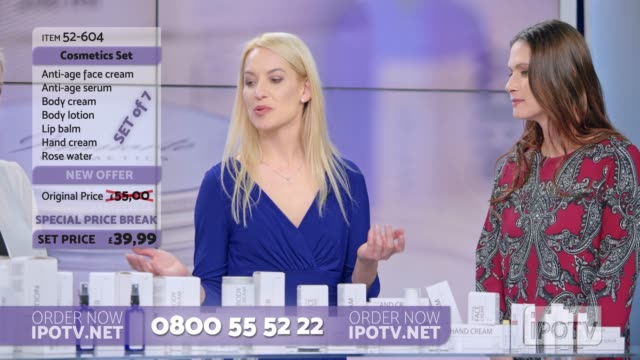 uk infomercial montage: woman presenting a cosmetic line on an infomercial show with the help of a female host and a model - television host stock videos & royalty-free footage