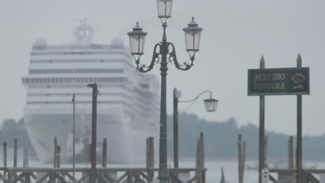 ws information sign at servizio gondola, cruise ship moving in background / venice, italy  - information sign stock videos & royalty-free footage