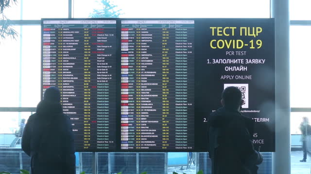 information sign directing to covid-19 vaccination center at domodedovo international airport. with sputnik v winning international recognition... - information sign stock videos & royalty-free footage