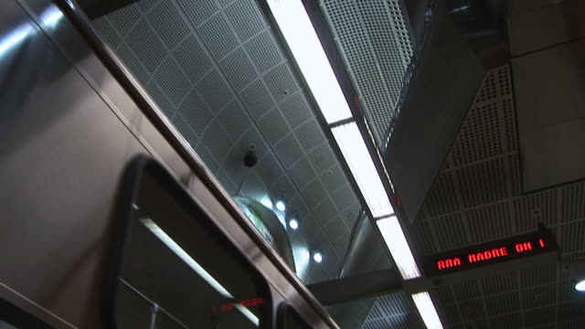 la information sign illuminated above a subway car traveling in train station / los angeles, california, united states - information sign stock videos & royalty-free footage