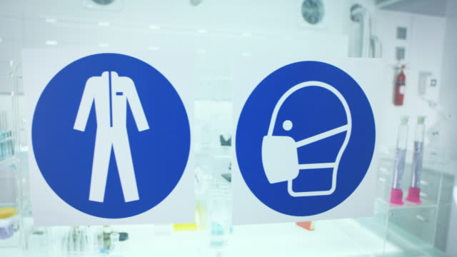 information sign in science laboratory. use protective workwear. - forbidden stock videos & royalty-free footage
