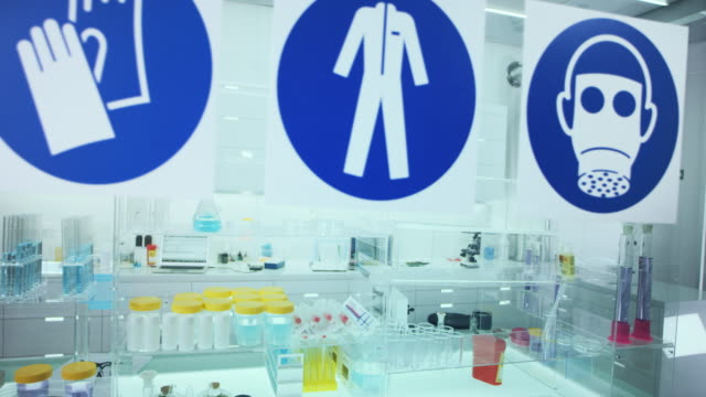 information sign in science laboratory. use protective workwear. - information sign stock videos & royalty-free footage